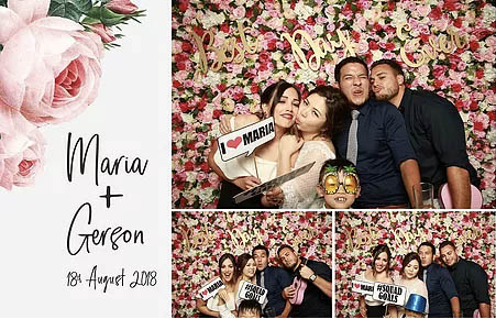 Photo booth print of a group in front of a flower wall posing