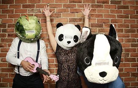 Photo showing three people in animal masks