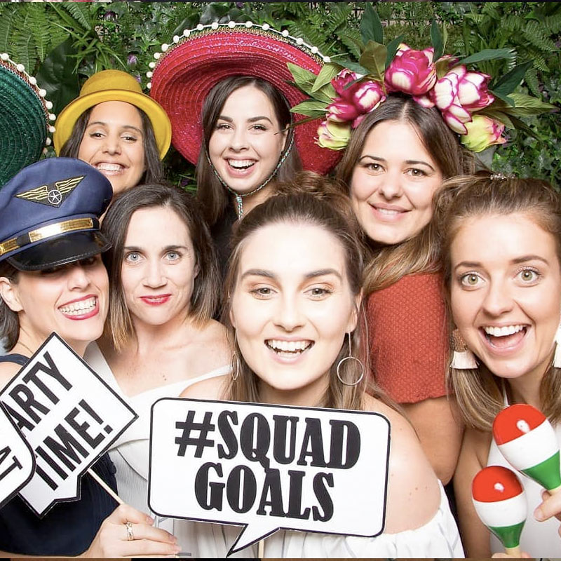 Group of girls dressed up in costumes at a photo booth rental