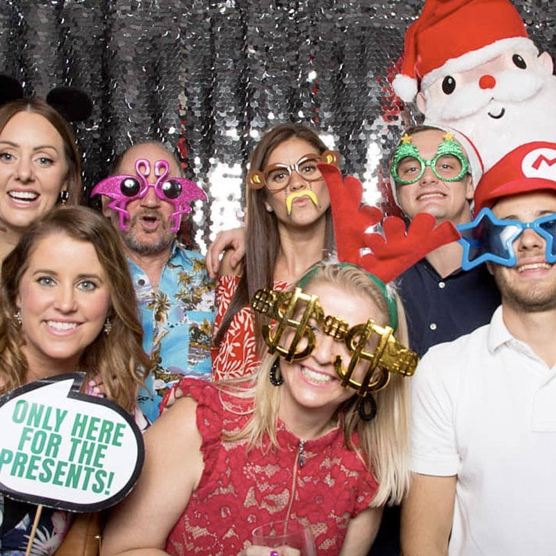 Group of friends in silly costumes at a photo booth
