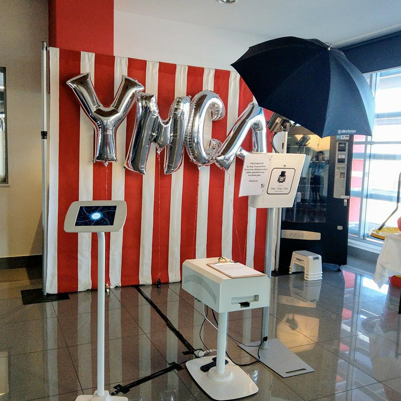 YMCA balloon on a red and white backdrop